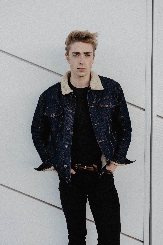 man wearing blue denim jacket and pants