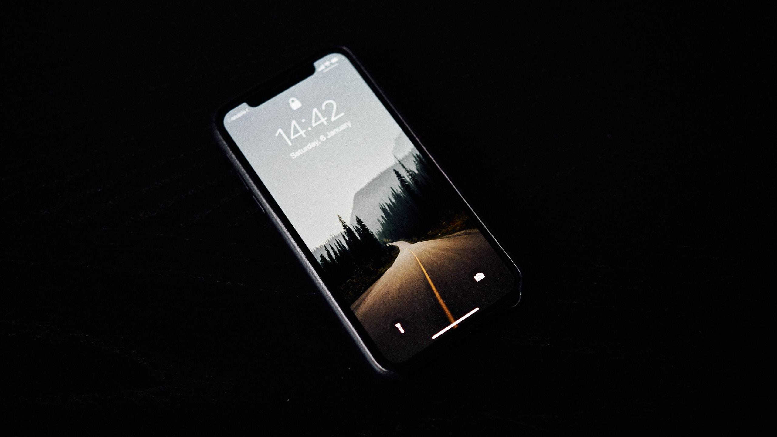 turned on black smartphone