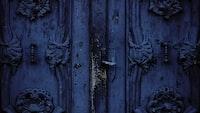 blue wooden ornate embossed door