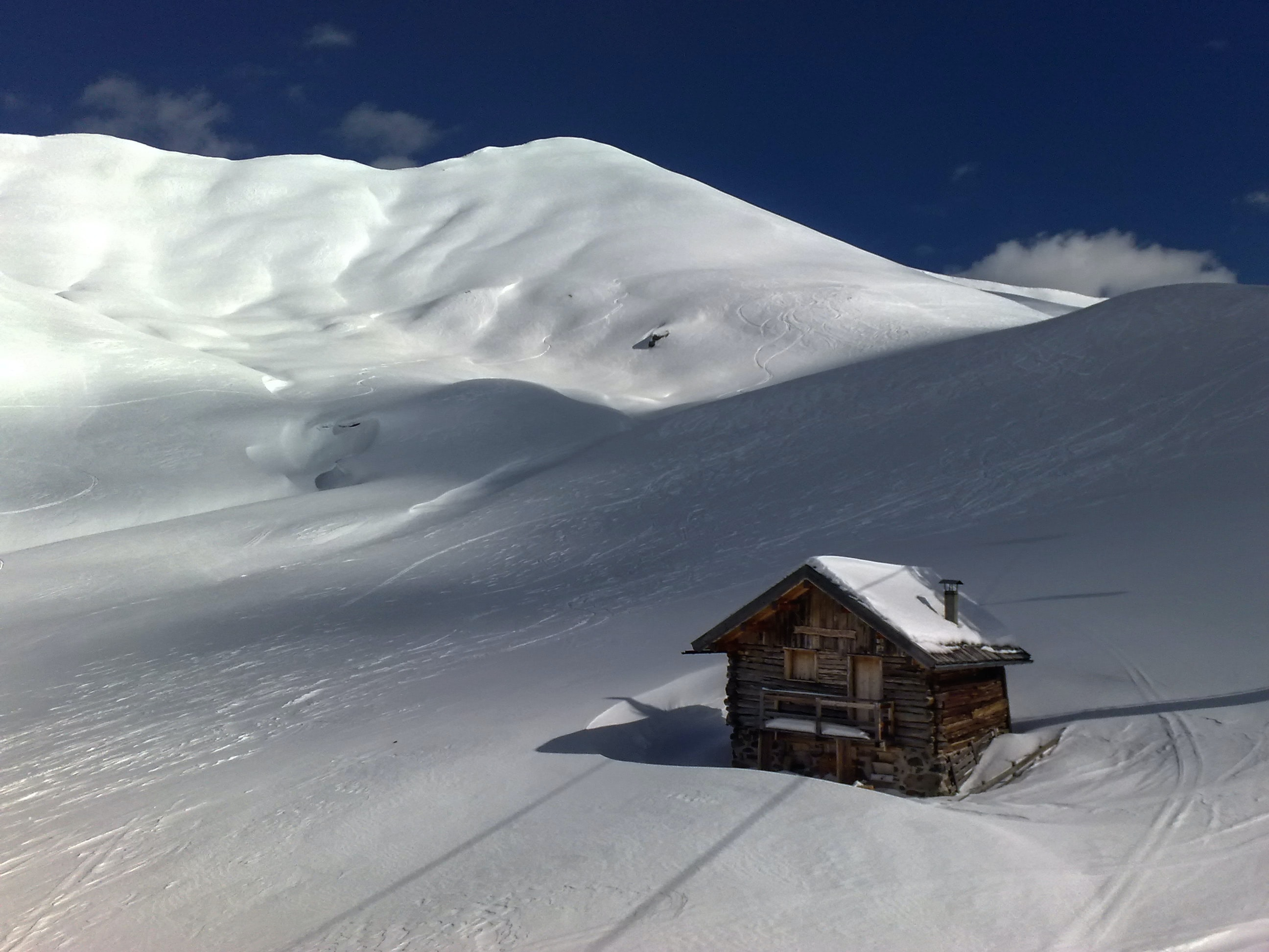 brown wooden house on the center of snow covered land