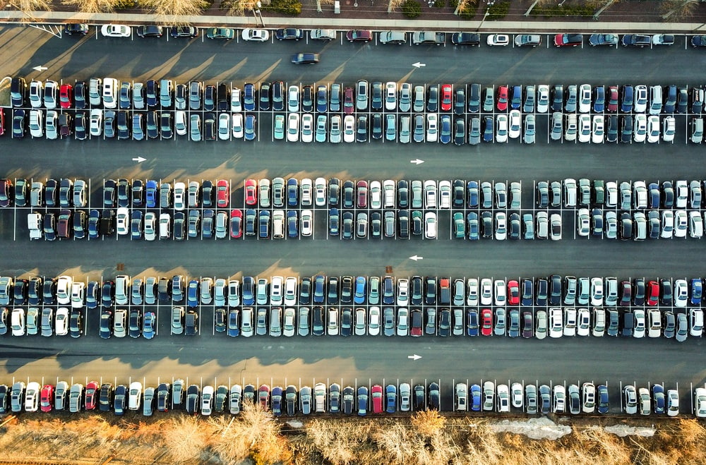 aerial view of assorted cars in parking lot