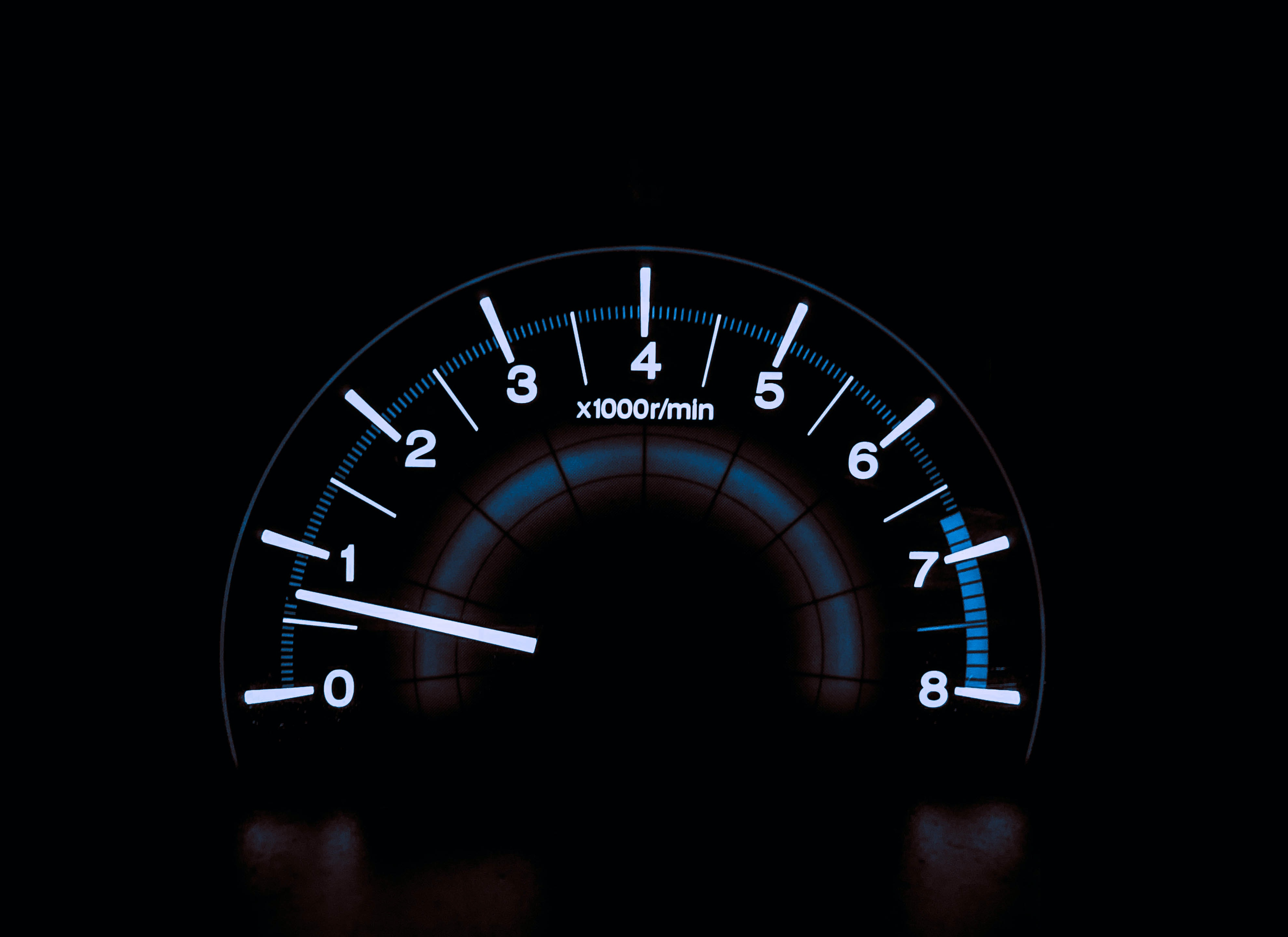 white and blue analog tachometer gauge