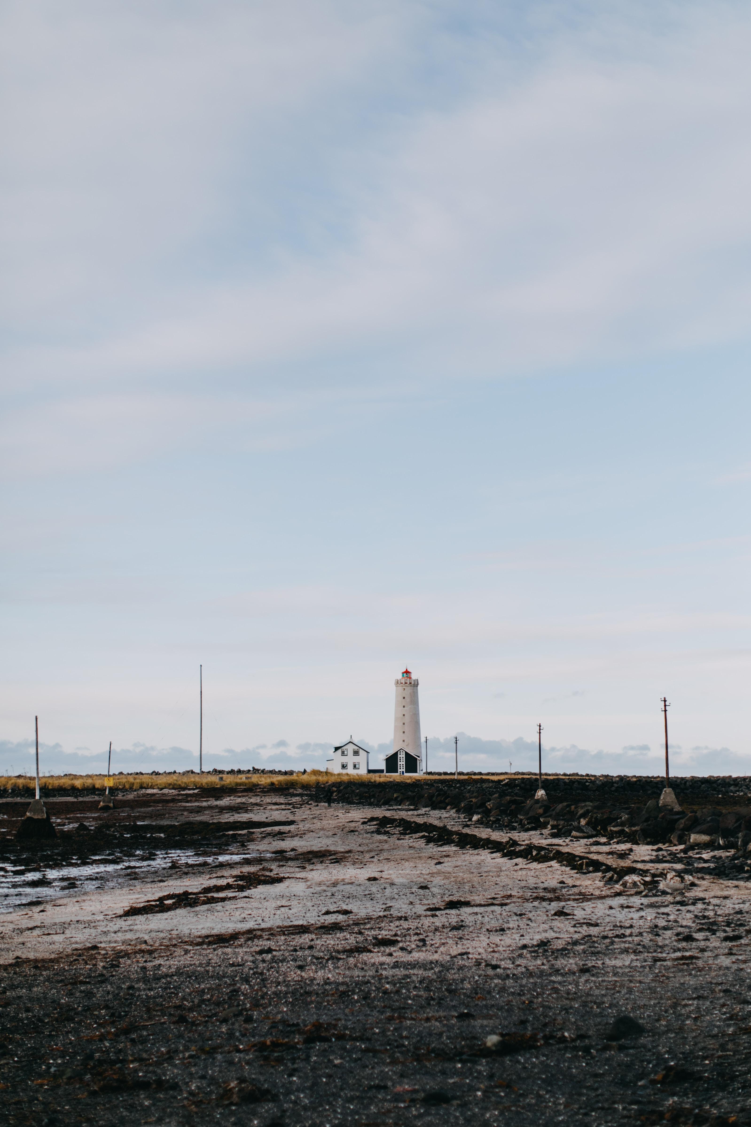 white concrete lighthouse under sky