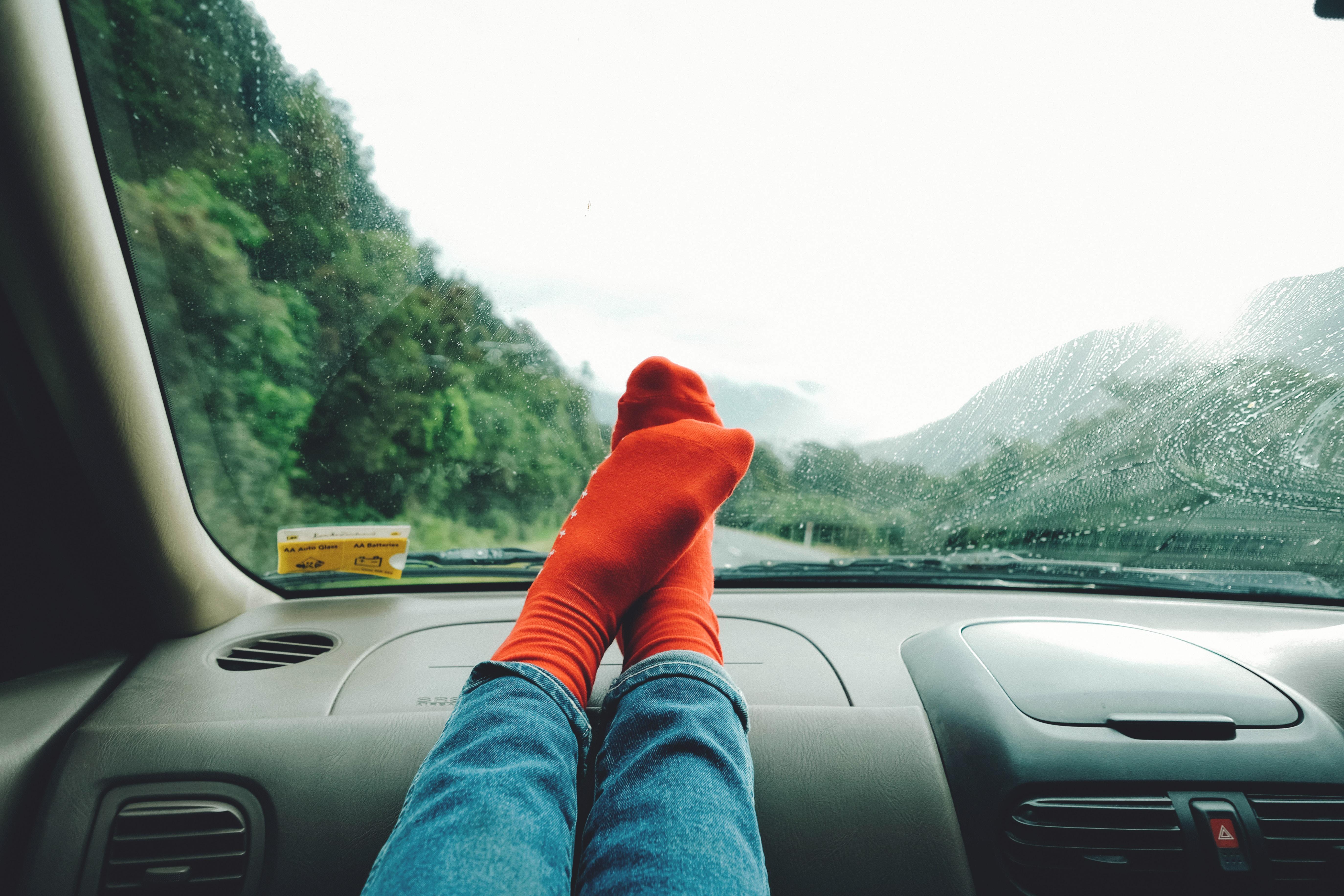 person wearing red socks near mountain