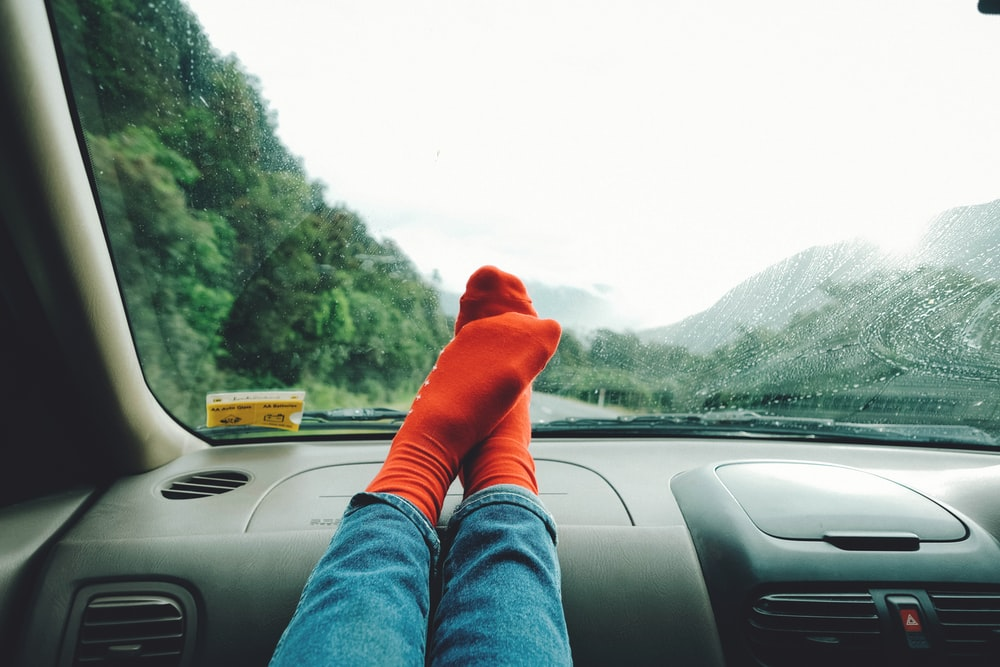 person wearing red socks near mountain