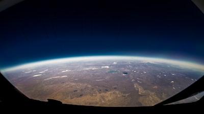 Cruising at 47000 feet over Kazakhstan. Shot with an 8mm fisheye lens.
