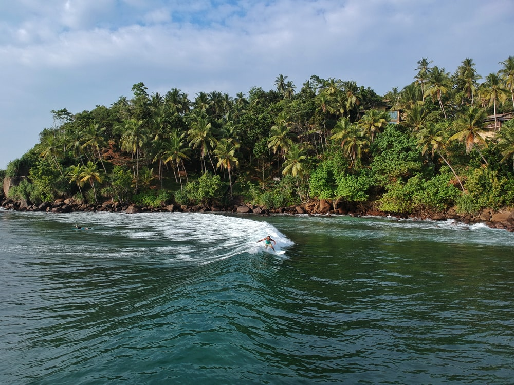 ocean waves towards island during daytime