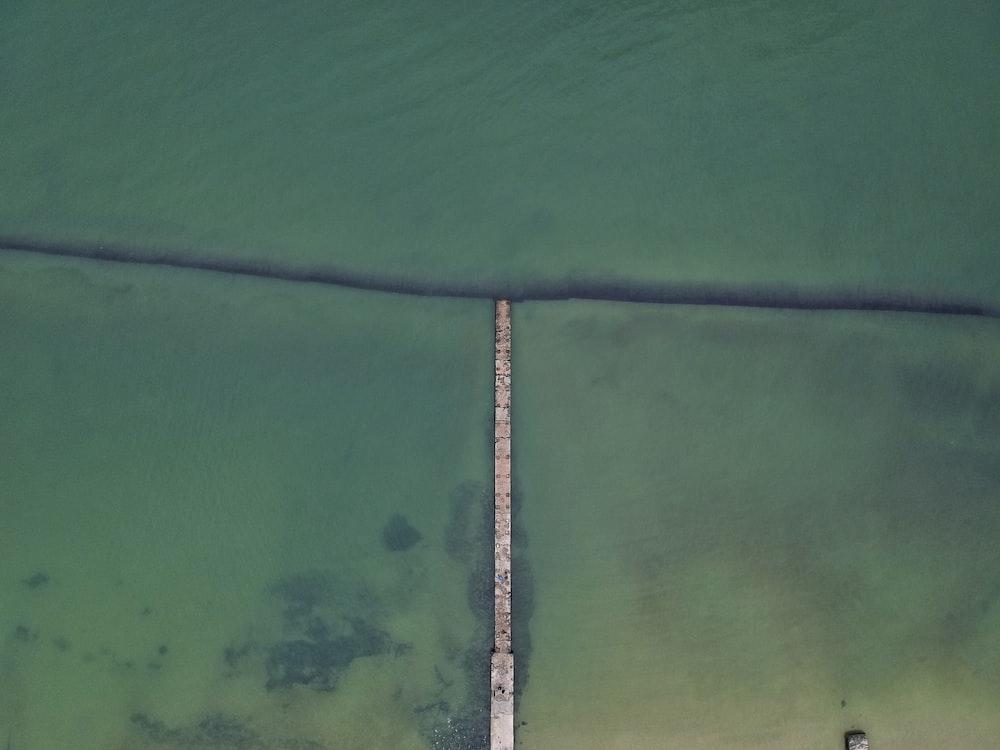 aerial photograph of sea and bridge