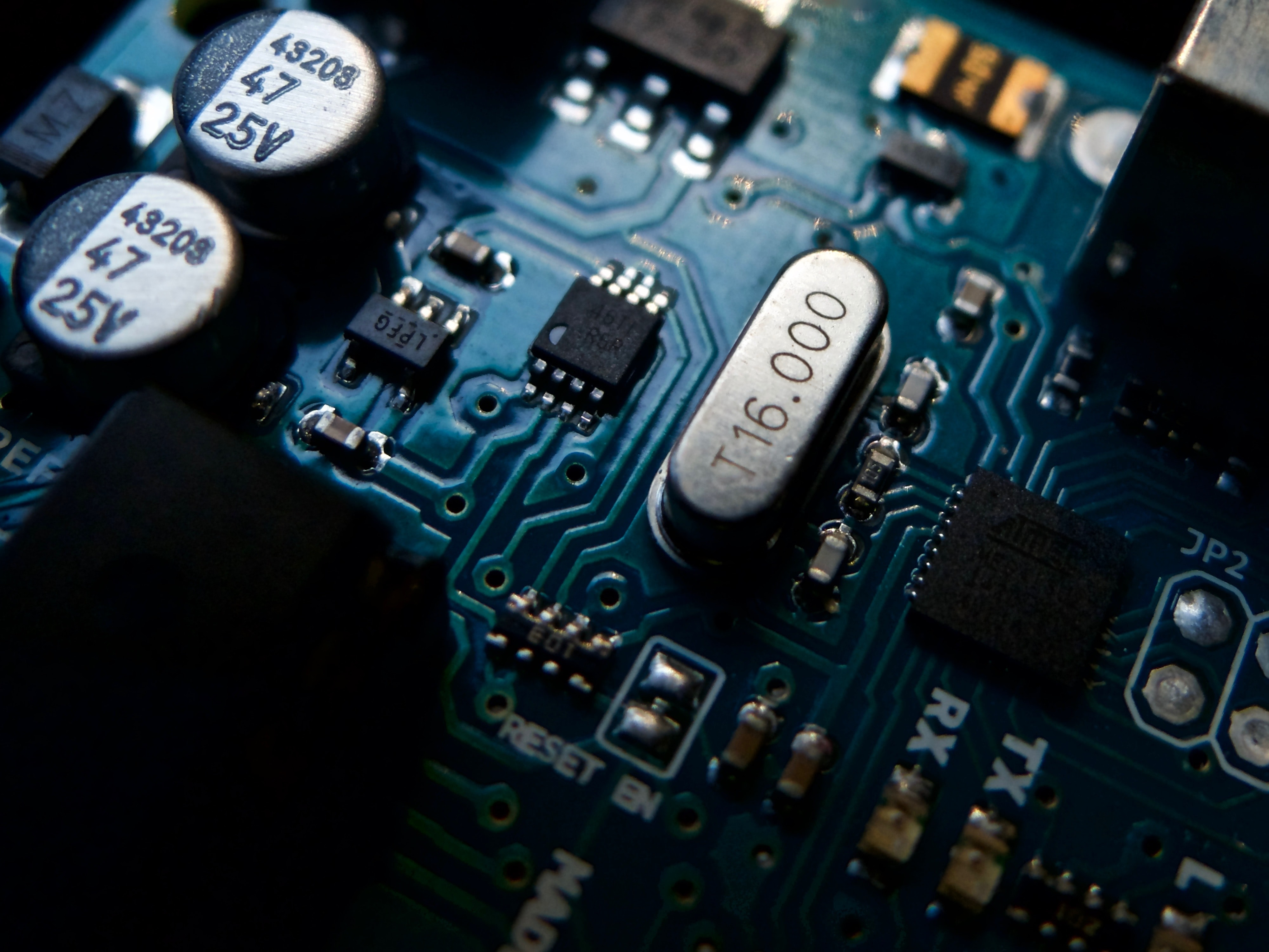 focus photo of gray and black circuit board