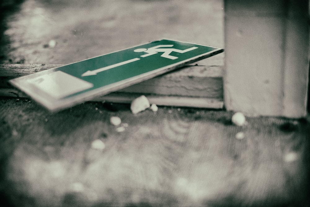 green sign board on ground