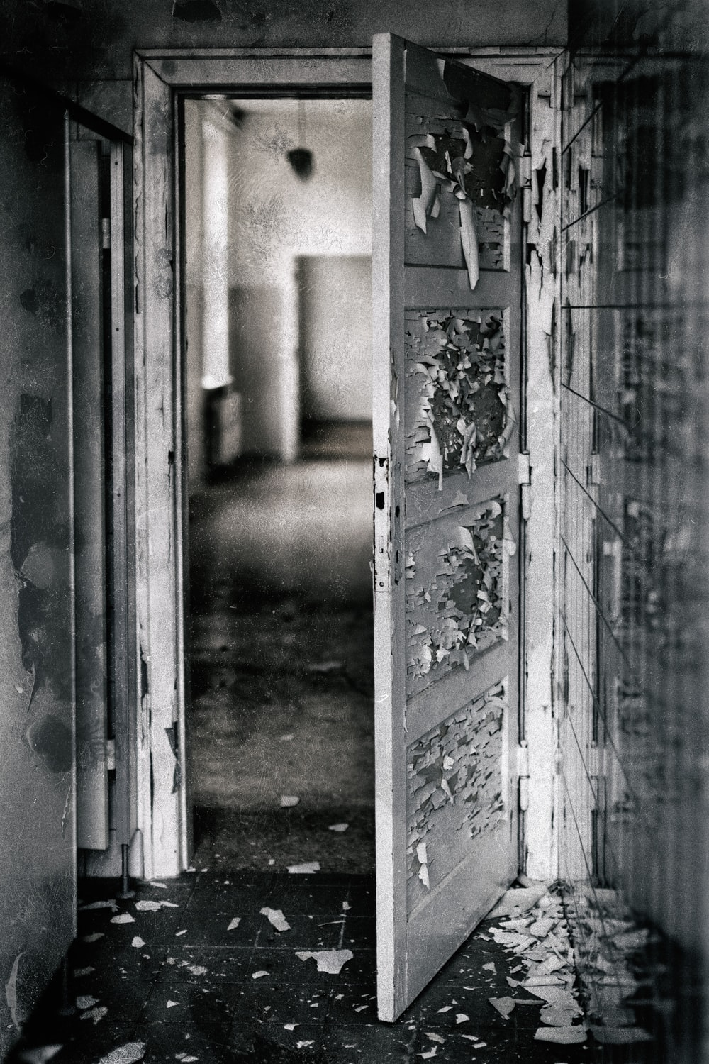 grayscale photography of opened door