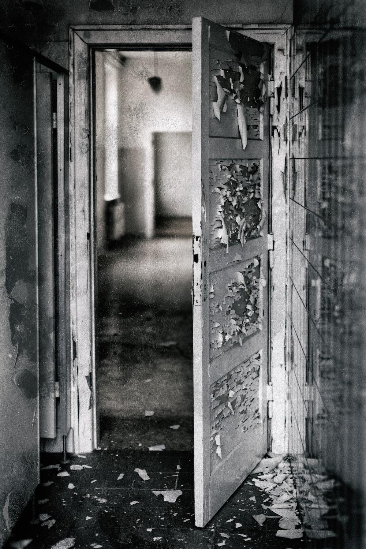 grayscale photography of opened door