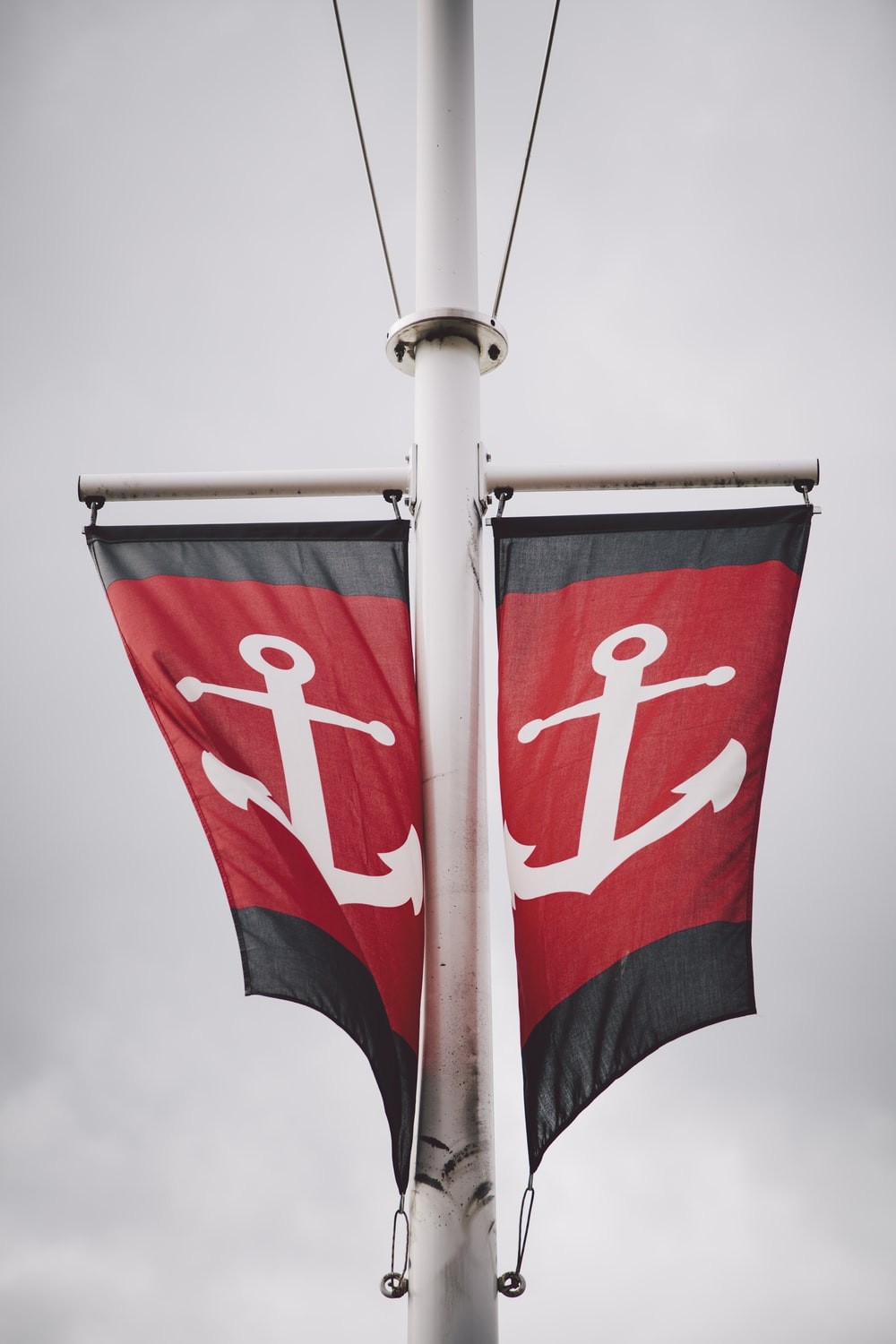 red and white anchor flags on ship