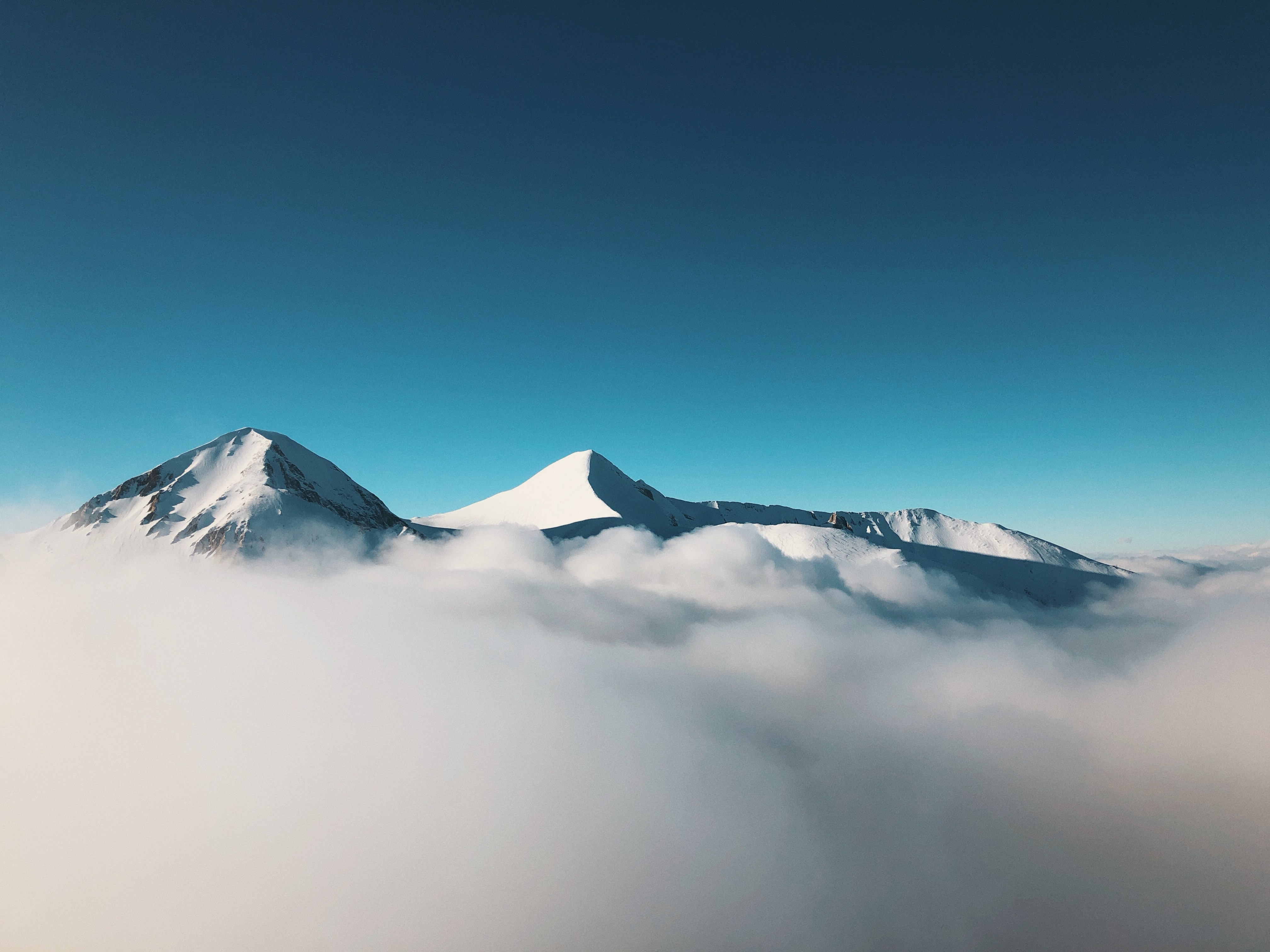 photo of mountain covered with fog