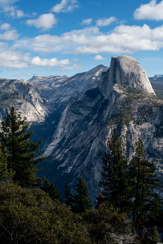 rock peak mountain under gray clouds
