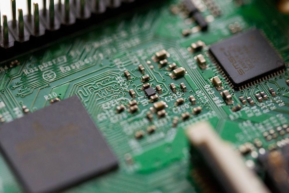 tilt-shift photography of green computer motherboard