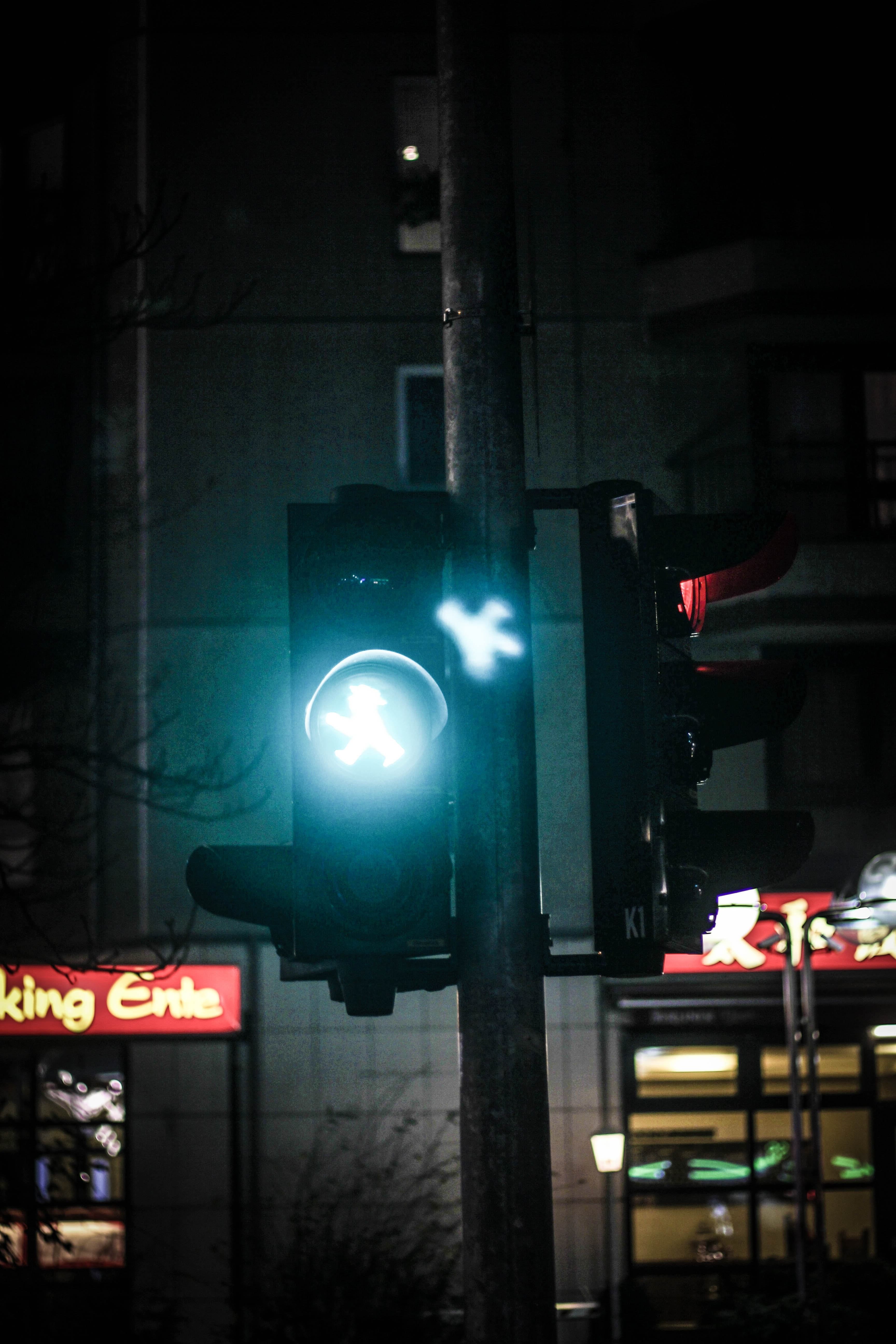 streetlight showing go sign during nighttime