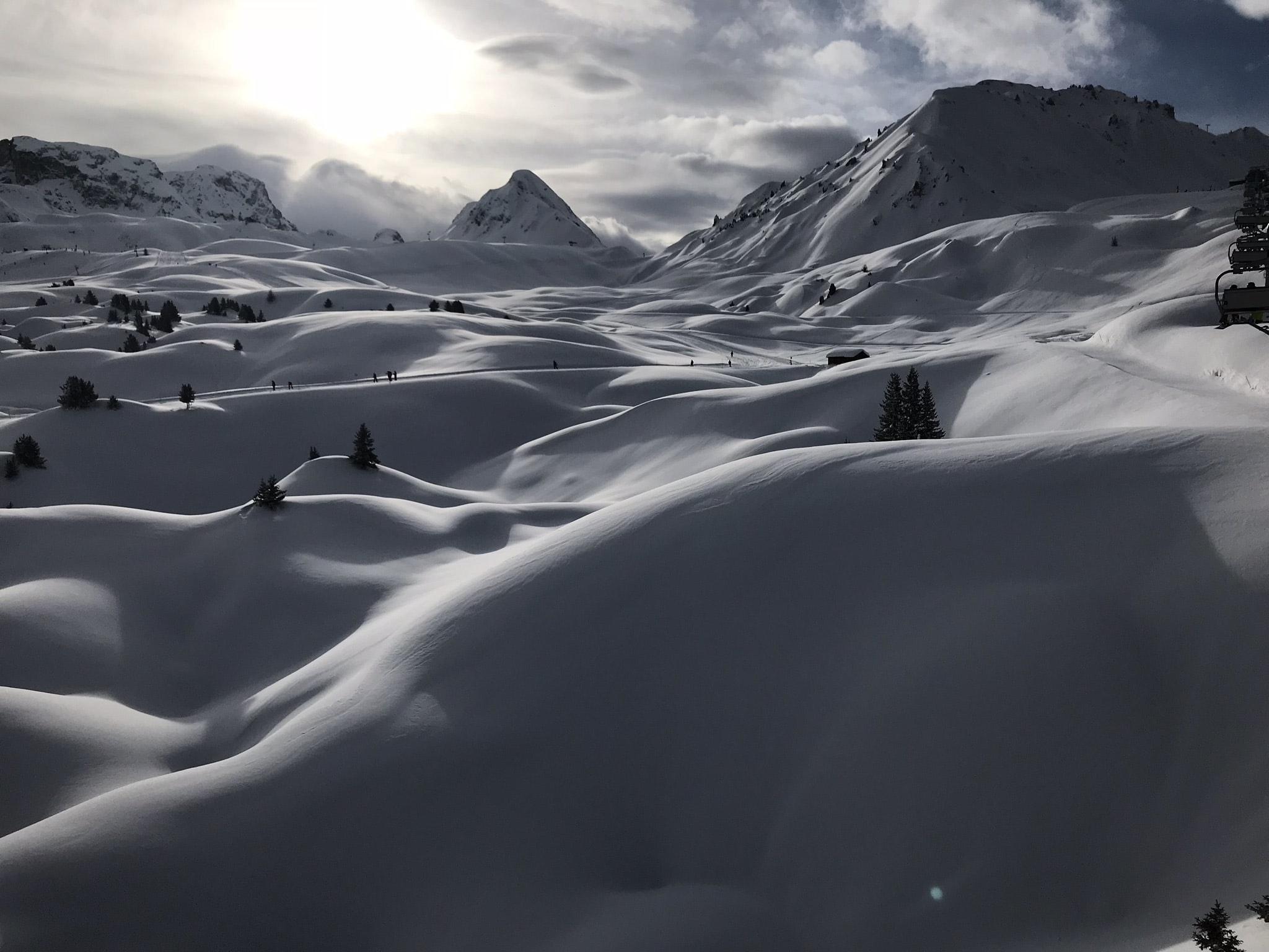 white snow and mountains at daytime