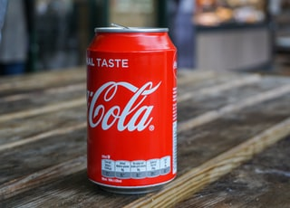Coca-Cola can on brown wooden table