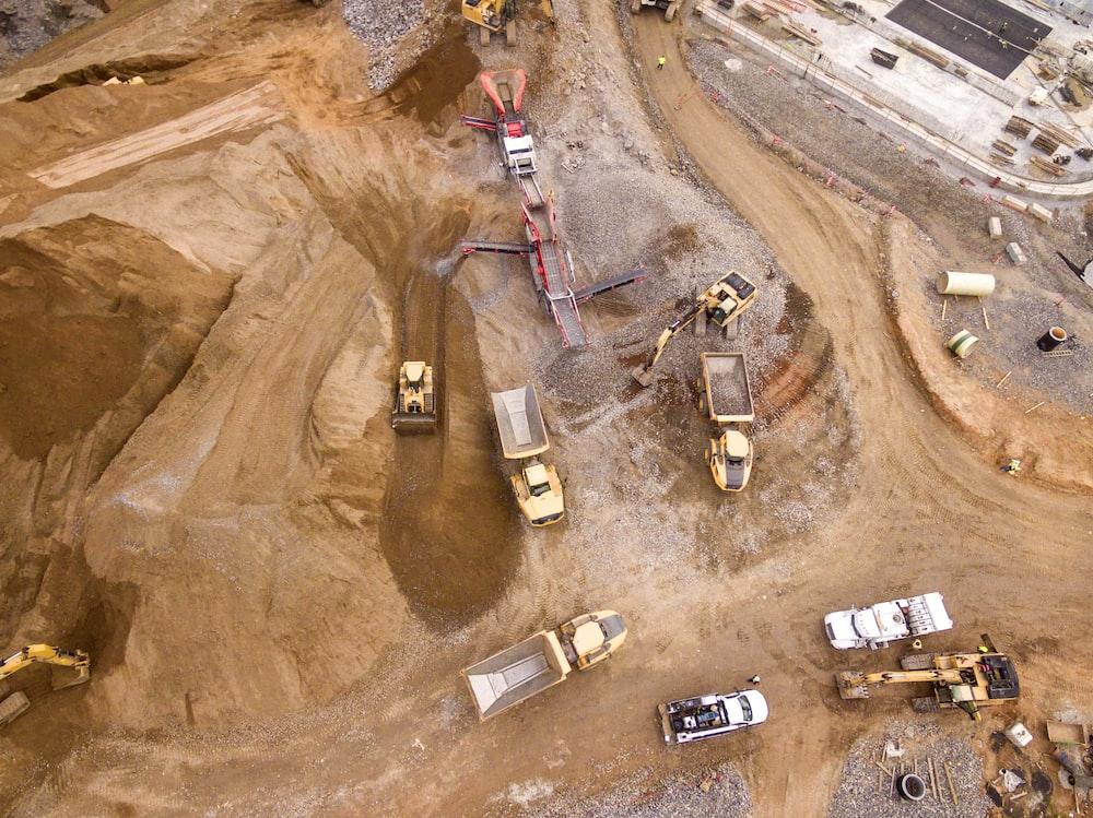 aerial photography of dump trucks