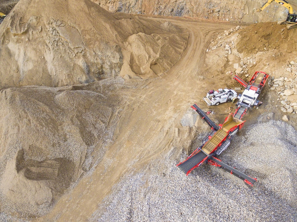 aerial photo of heavy equipment on mining site