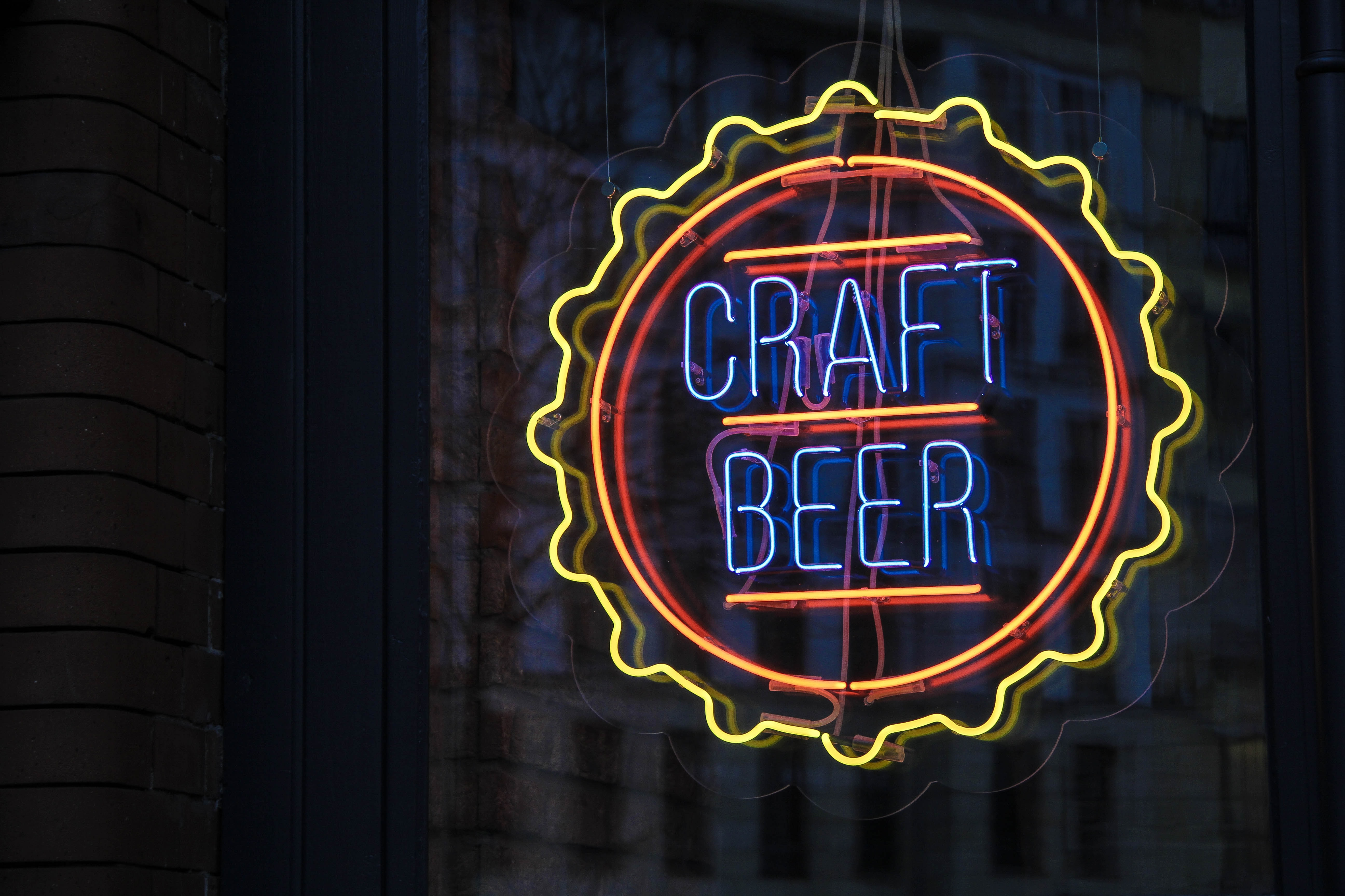 blue, yellow, and red Craft Beer lighted signage