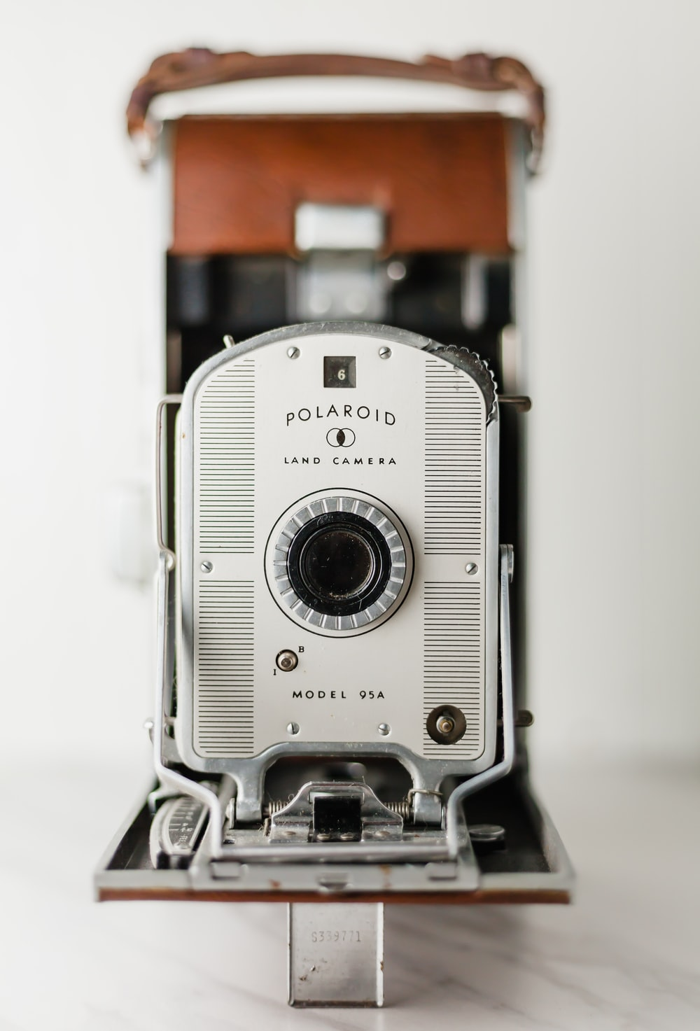 silver and brown Polaroid land camera