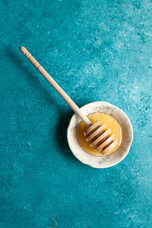 brown wooden stick on beige ceramic bowl