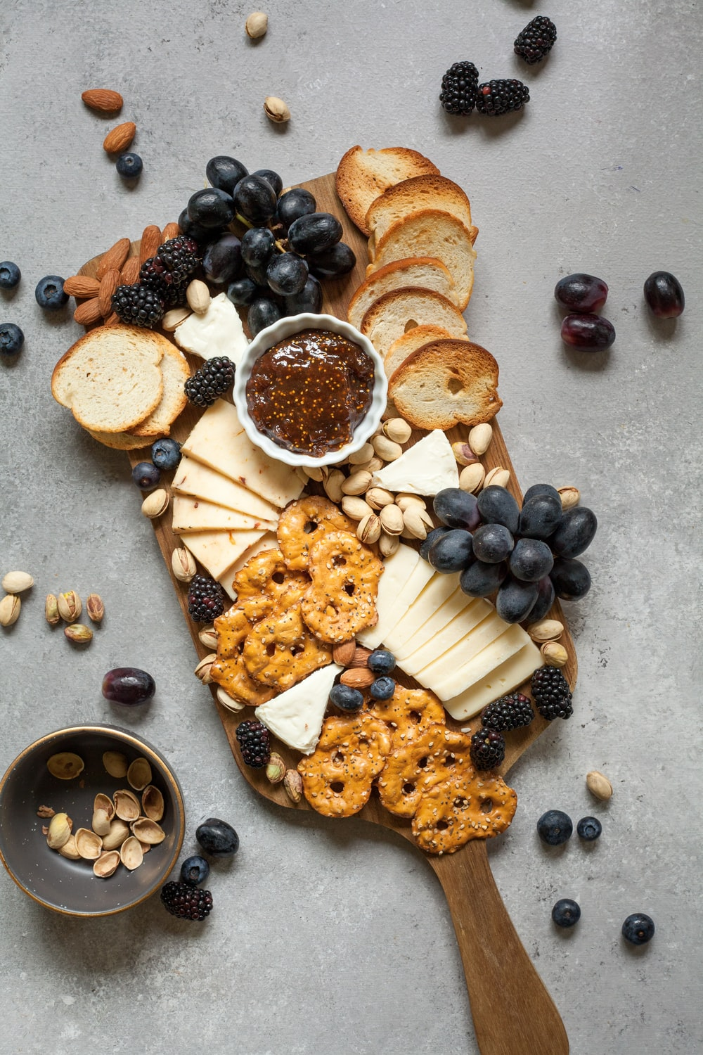 baked breads and cookies on brown wooden board