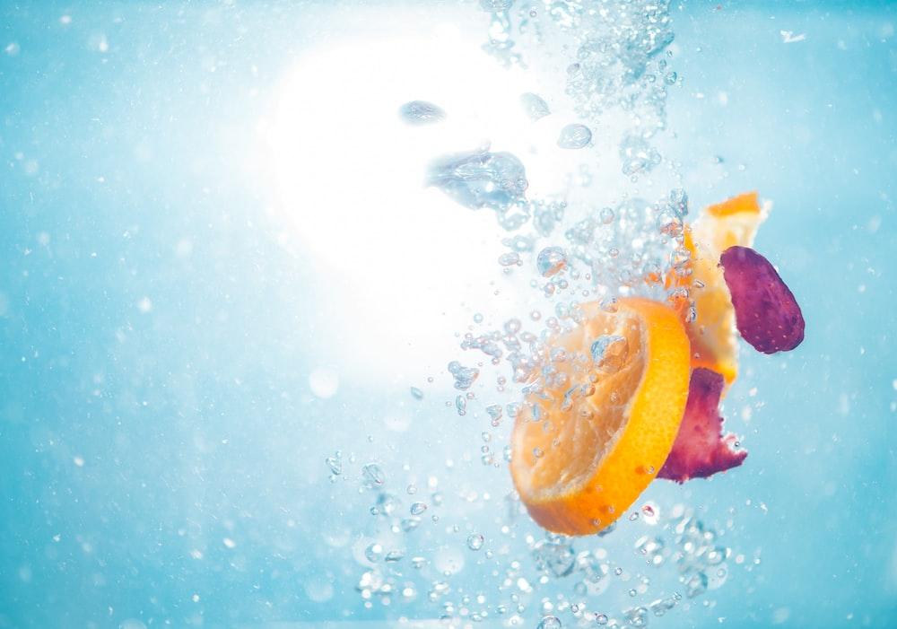 photo of sliced lemon on water