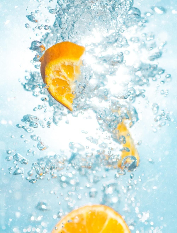 sliced orange fruits underwater