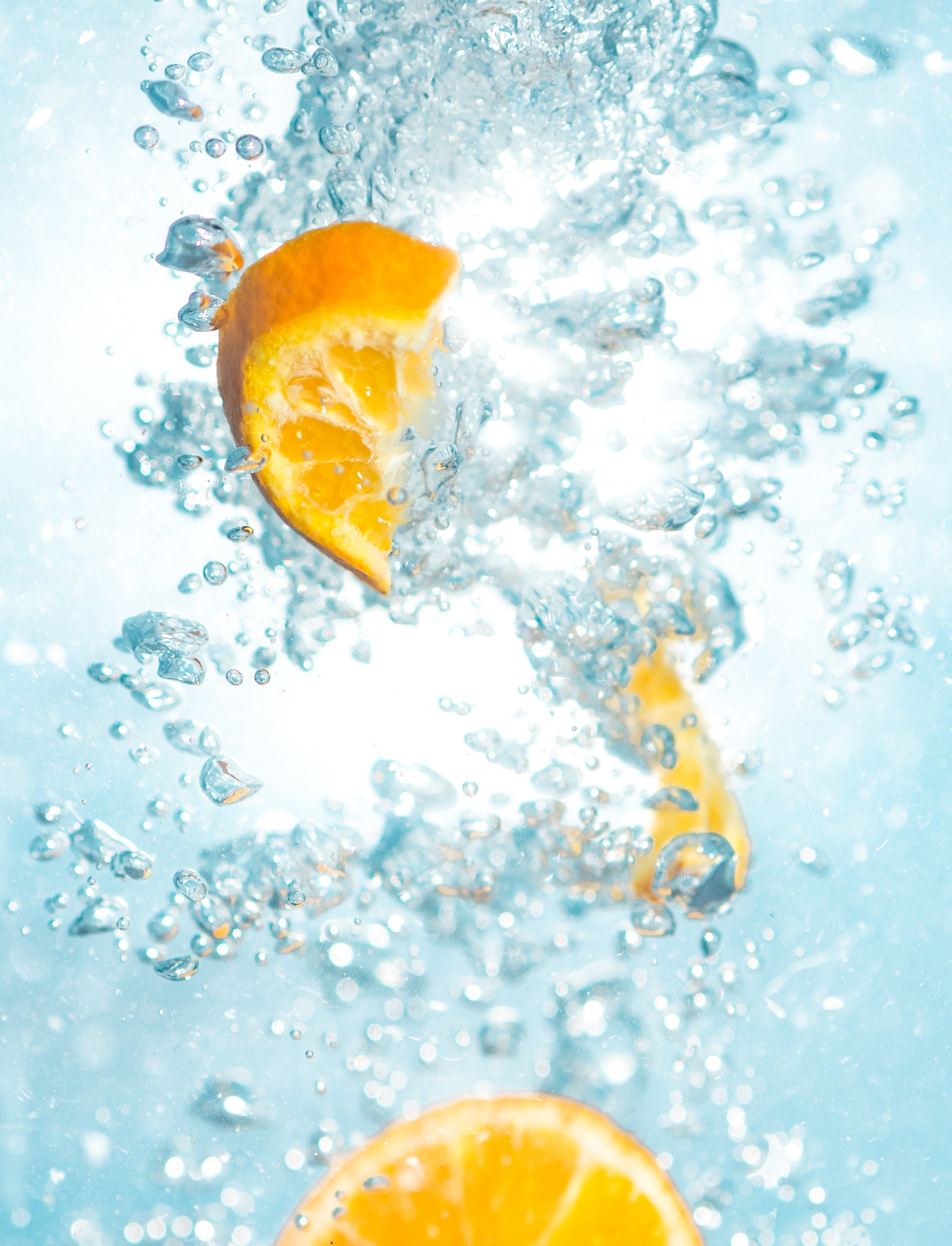sliced orange fruits underwater
