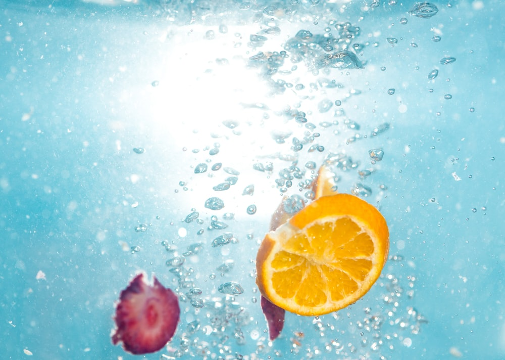 orange lemon fruit under water