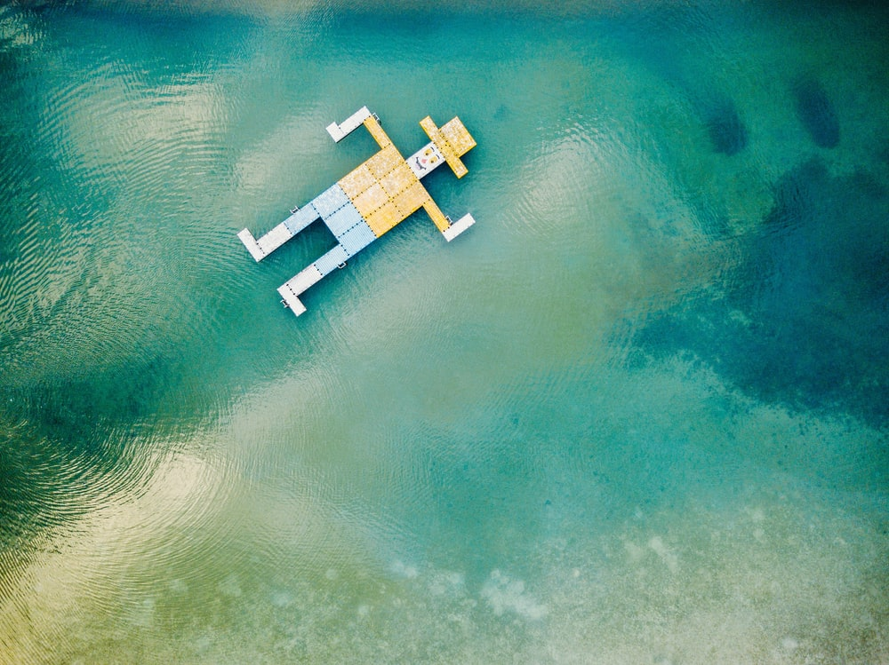 wooden toy floating on body of water
