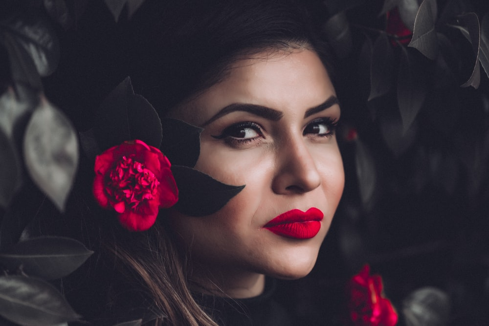 woman in red lipsticks