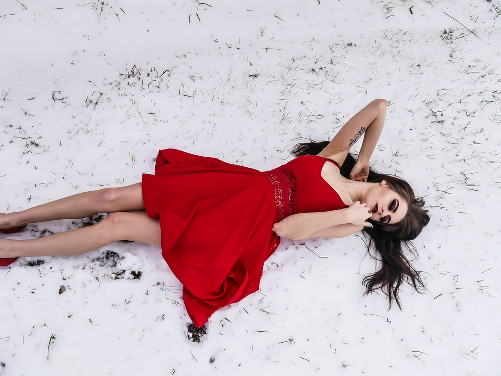 woman lying on snow
