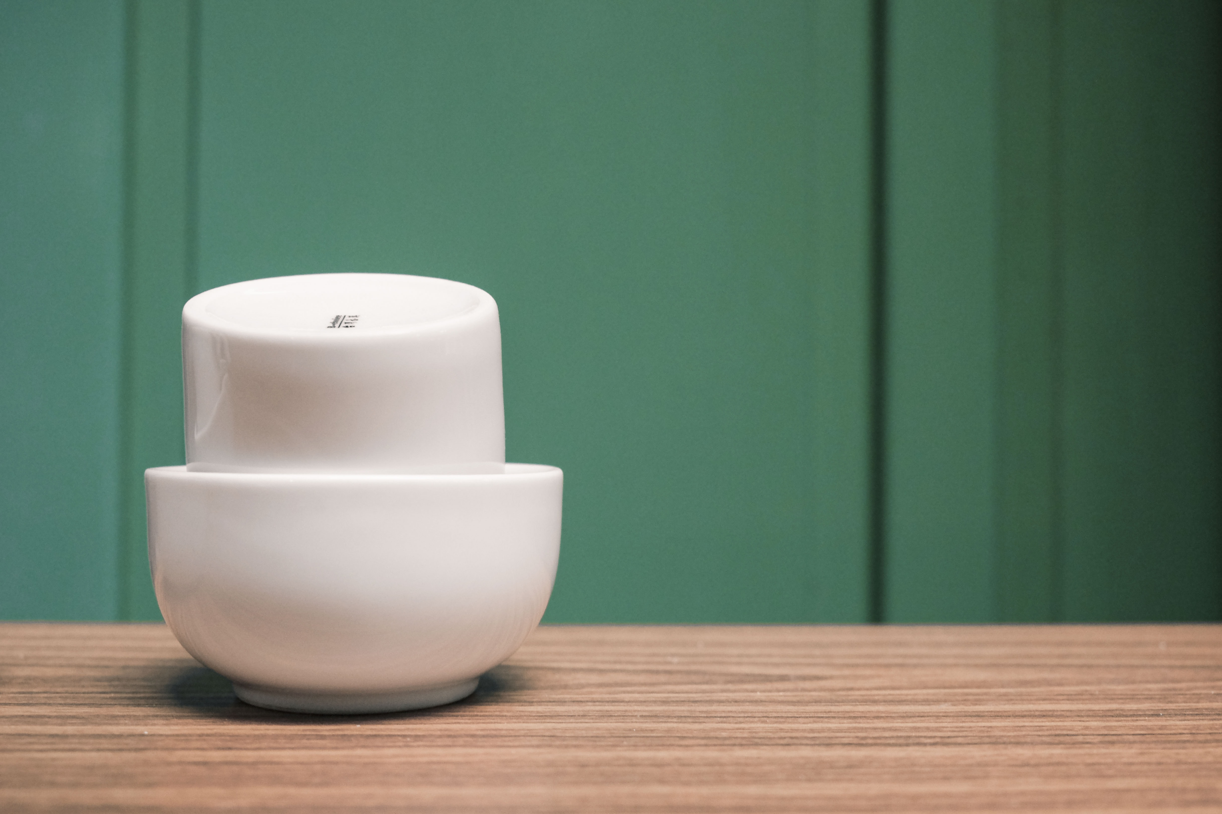 two white bowls on table