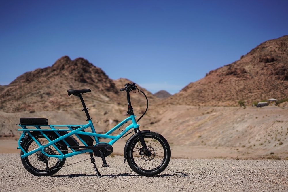 blue bicycle near mountain