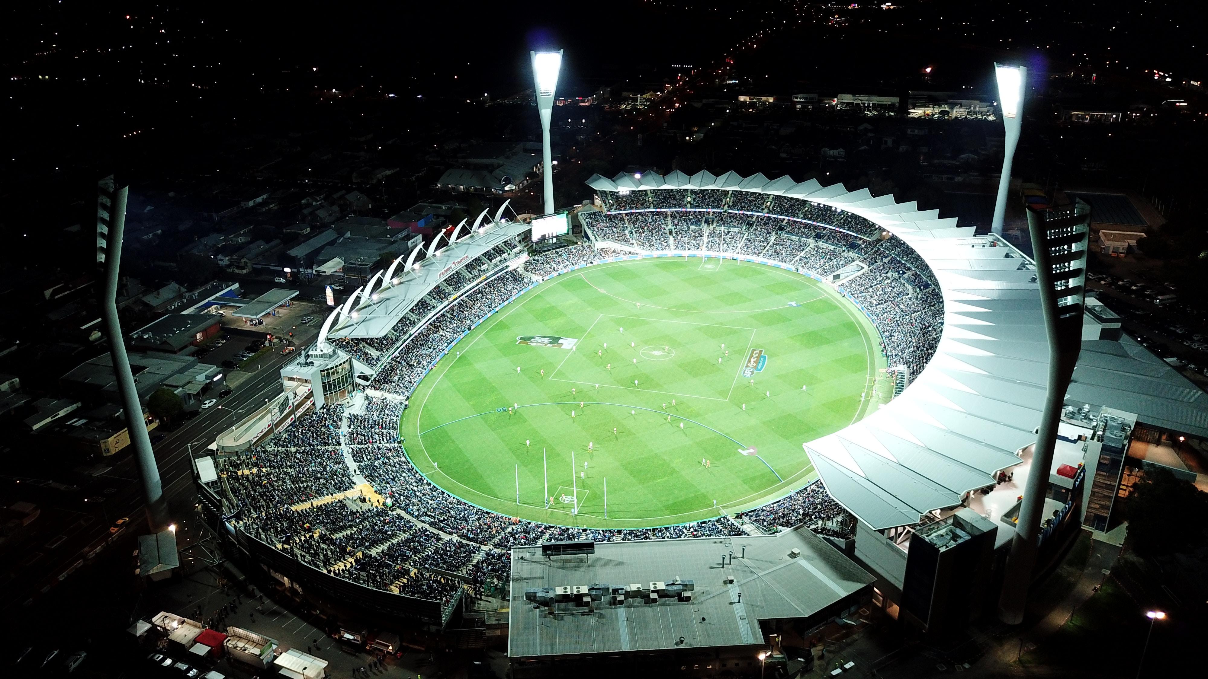 high-angle photo of round stadium at nighttime