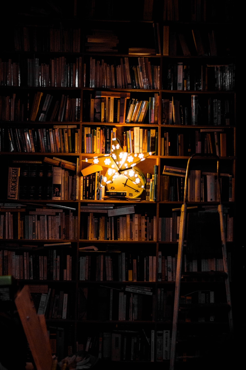 photography of bookshelf and star LED light decor
