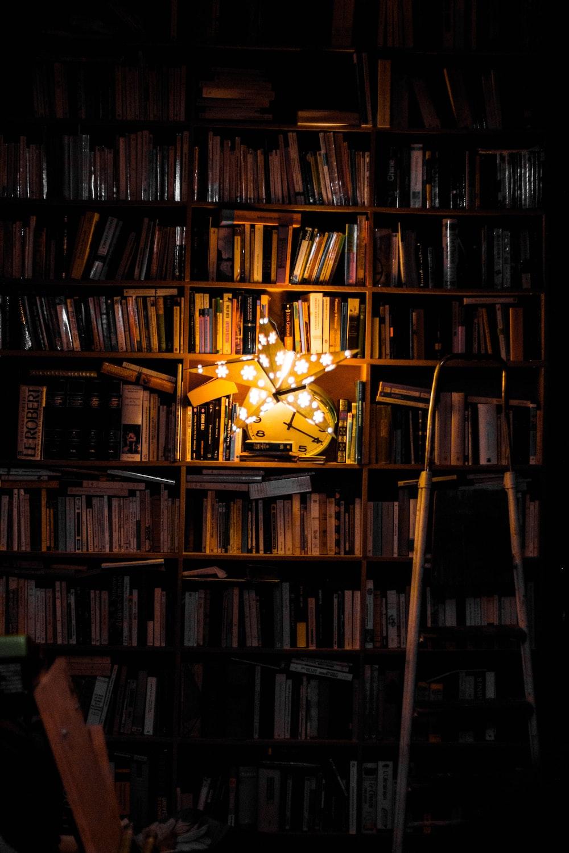 photography of bookshelf and star LED light decor