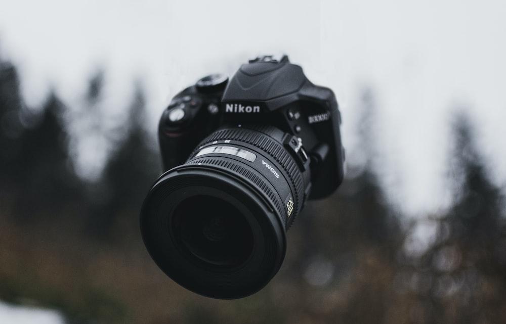 black Nikon DLSR camera