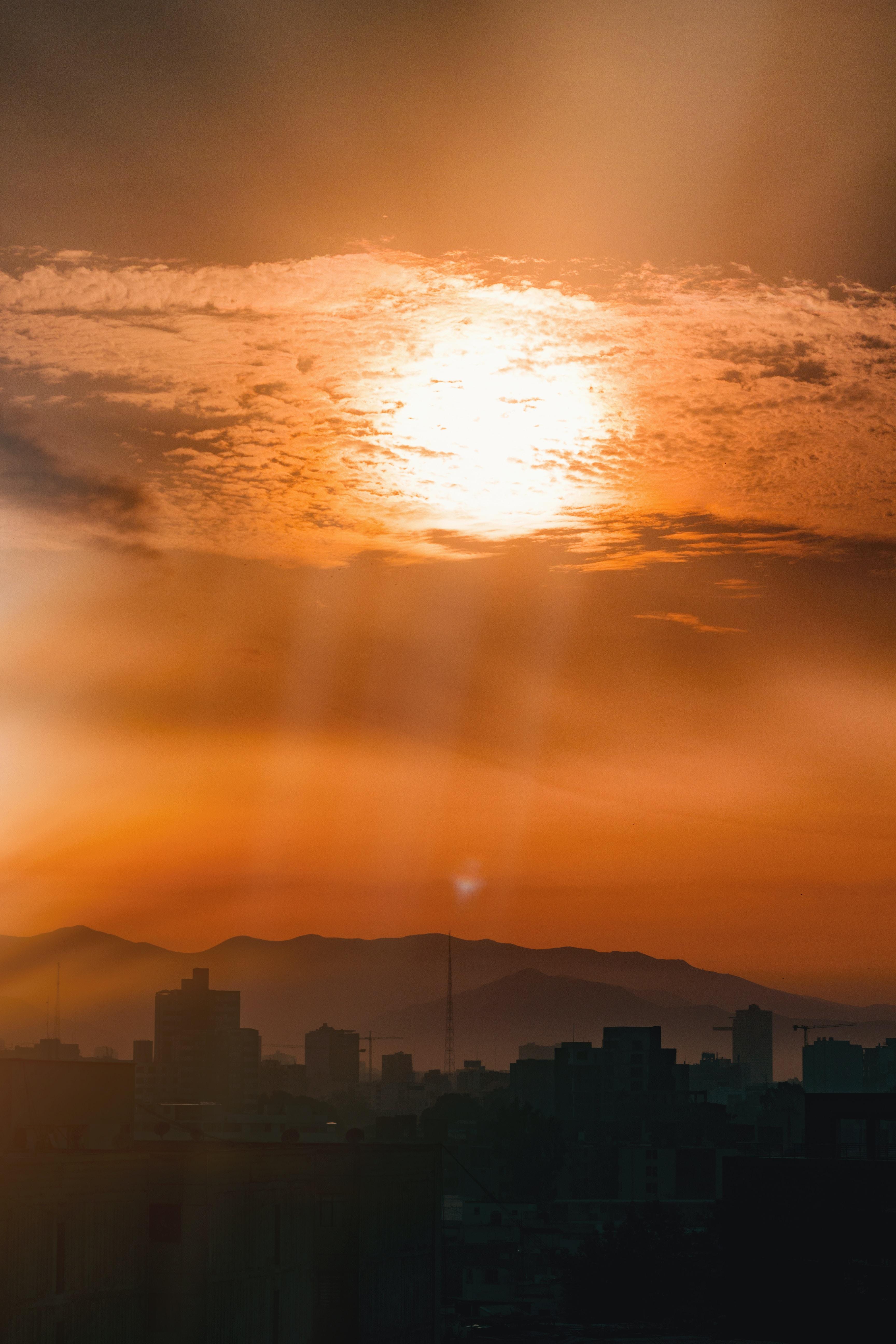 orange sunset above buildings
