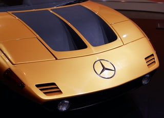 yellow and black Mercedes-Benz vehicle