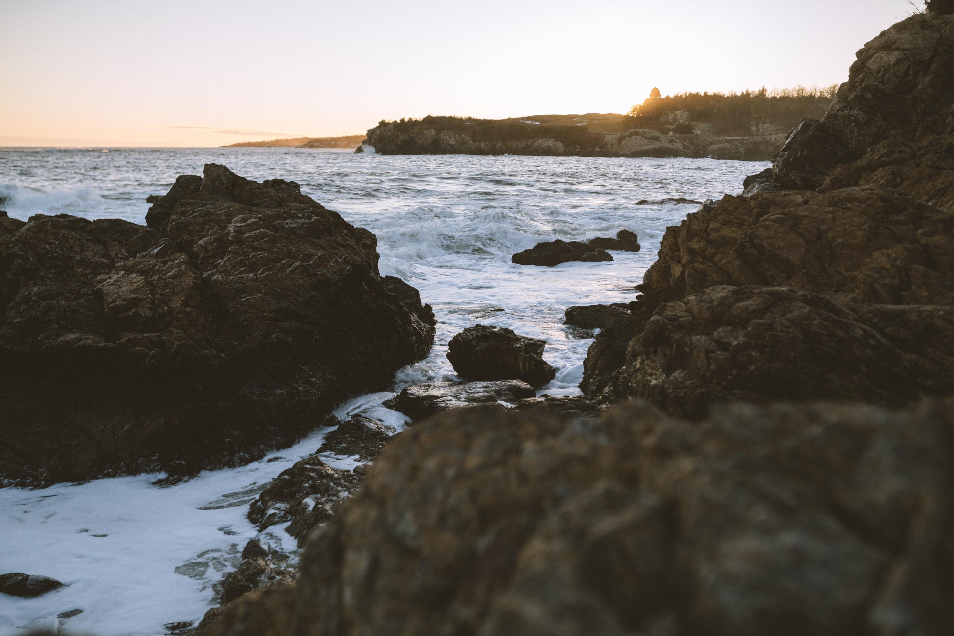 sea waves crashing to rocks