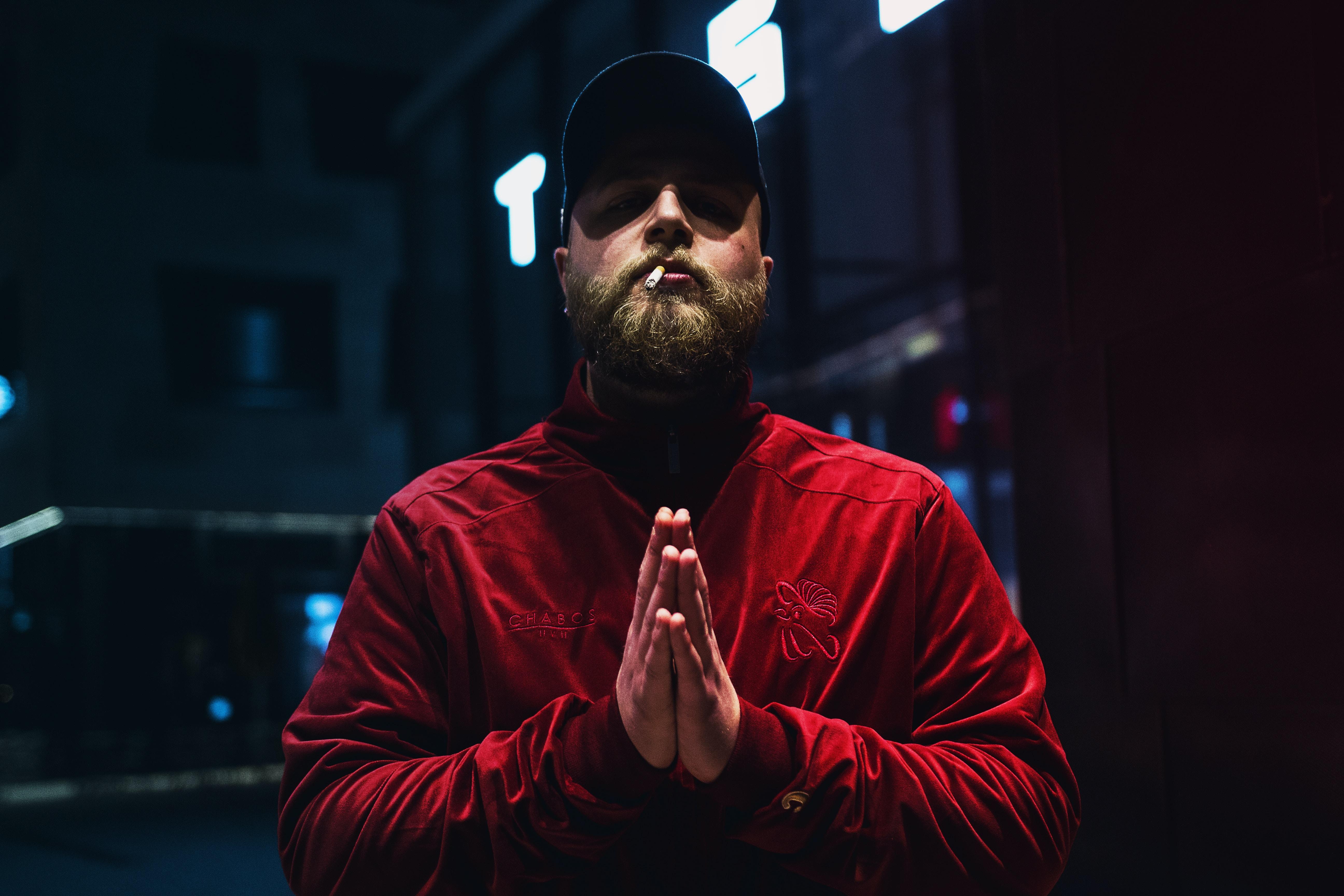 man wearing red sweatshirt