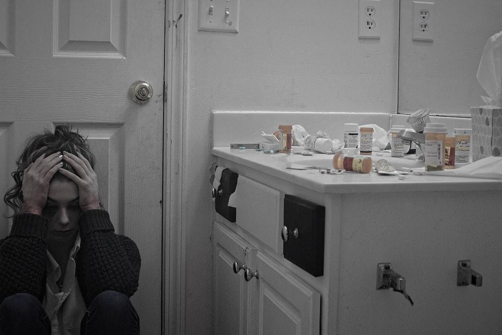 woman sitting in front of door