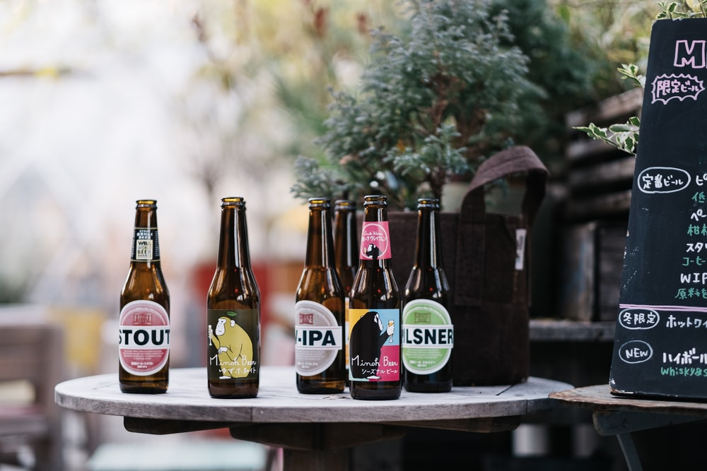 six label bottles on top of round table