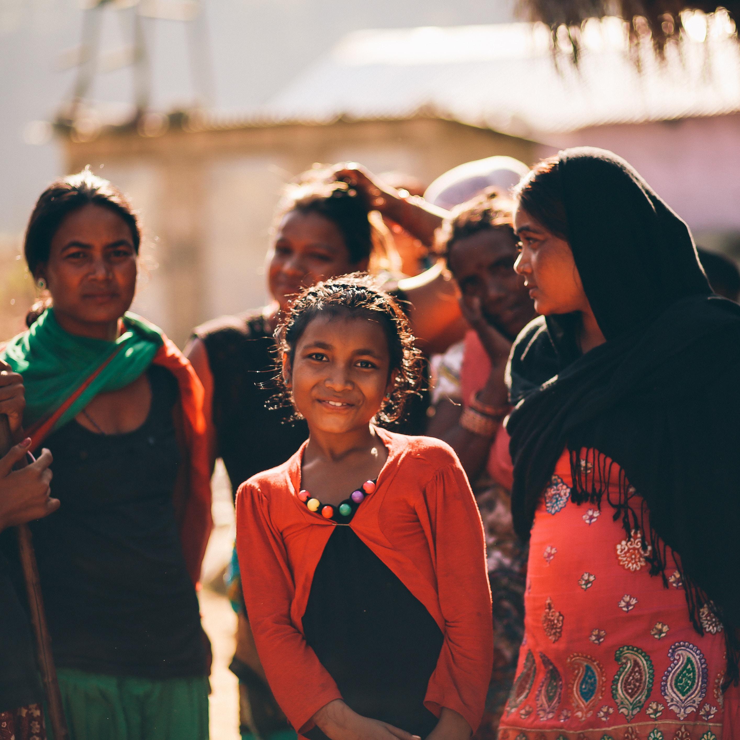 girl standing between group of women