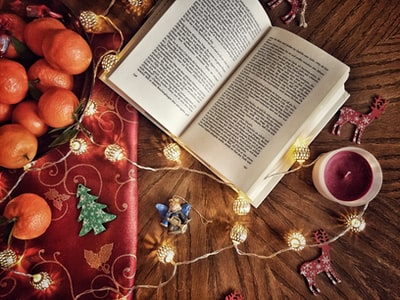 opened book beside tealight decorations zoom background